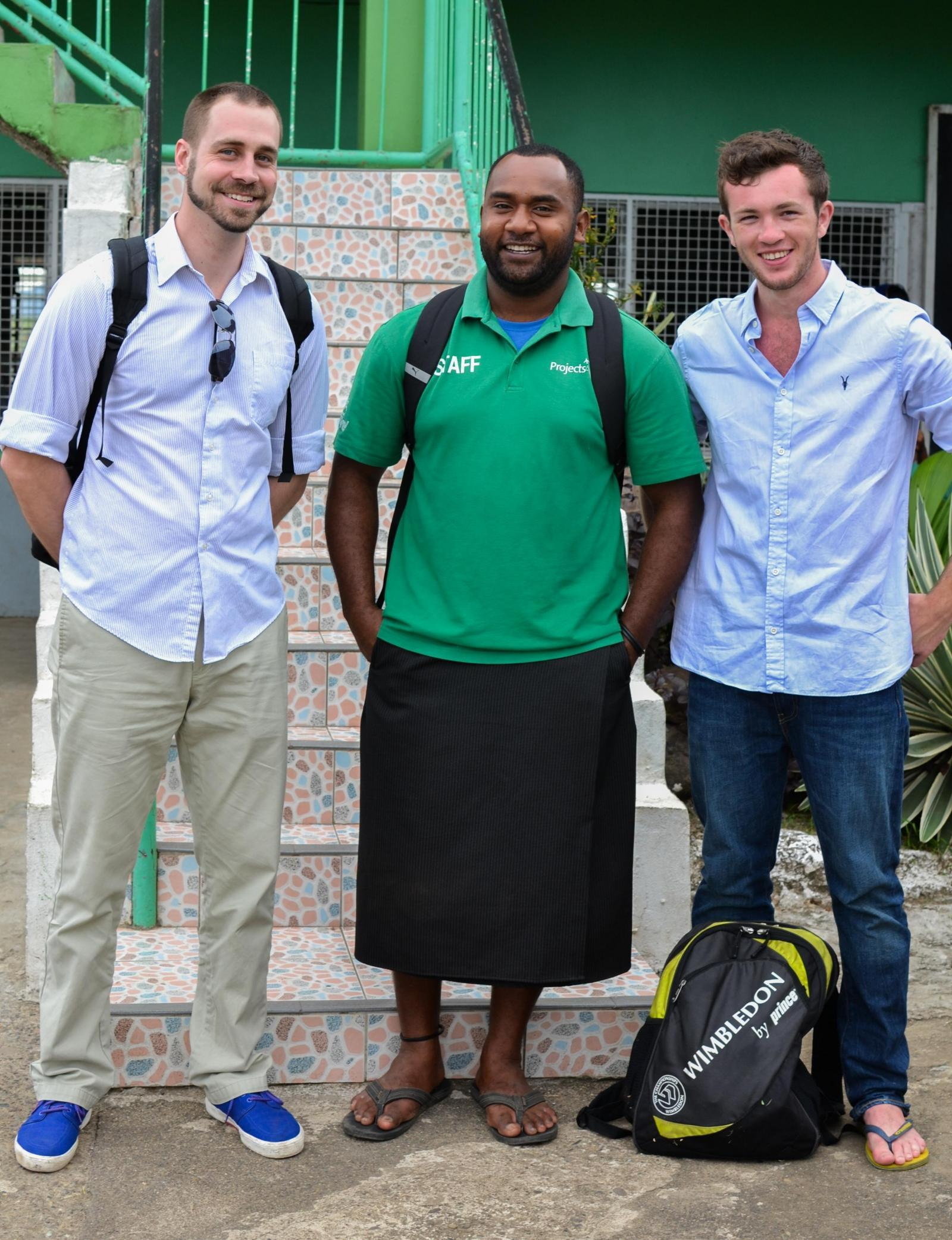 Projects Abroad volunteers pose for a photo with a staff member outside the placement in Fiji.